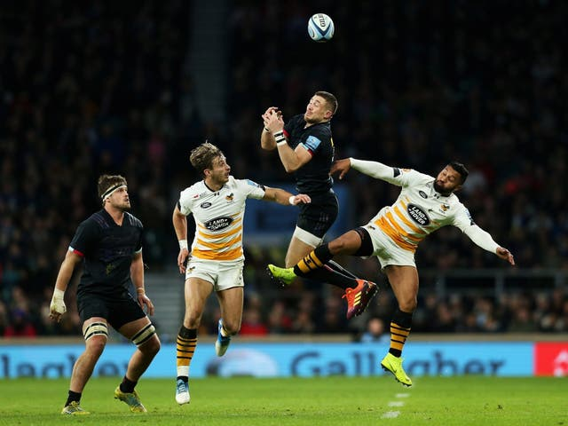 Mike Brown challenges for an aerial ball