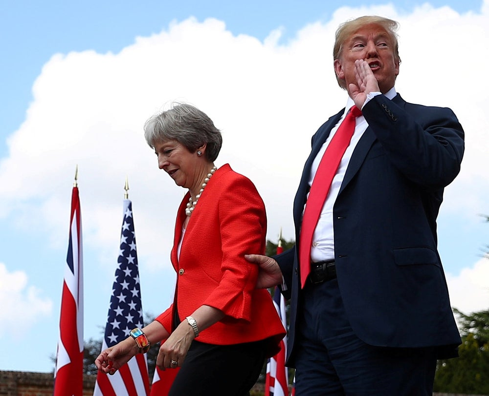 Reuters photographer Hannah McKay (Britain's Prime Minister Theresa May and U.S. President Donald Trump walk away after holding a joint news conference at Chequers)