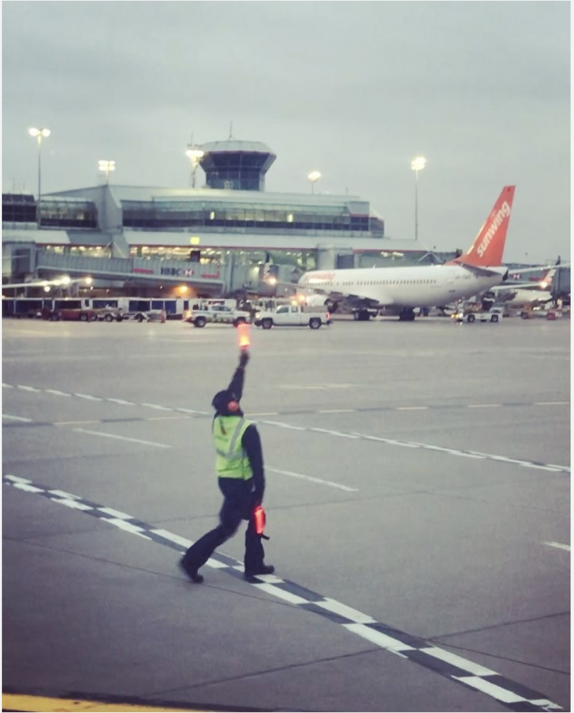 Colorado Independent: Toronto Airport Gate Agent Does Dance Routine To Signal