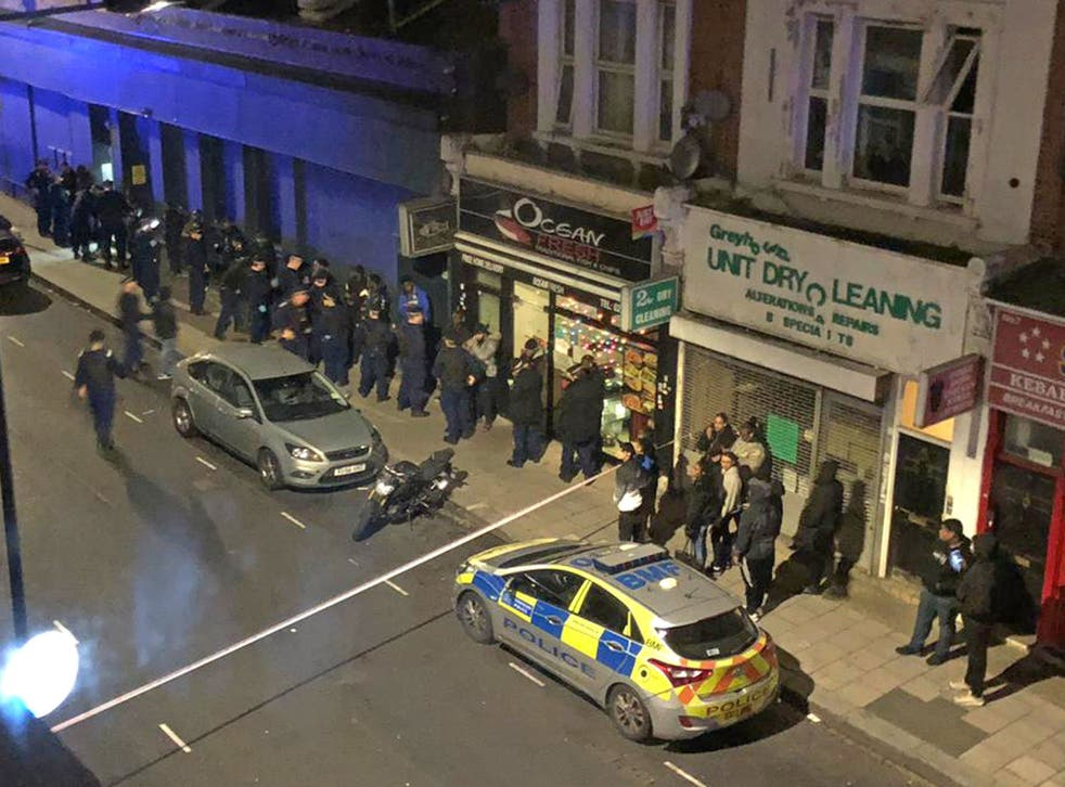 The scene opposite a property in Greyhound Road in Hammersmith, west London where thirty-nine people were arrested on suspicion of attempted murder following an incident on Fulham Palace Road
