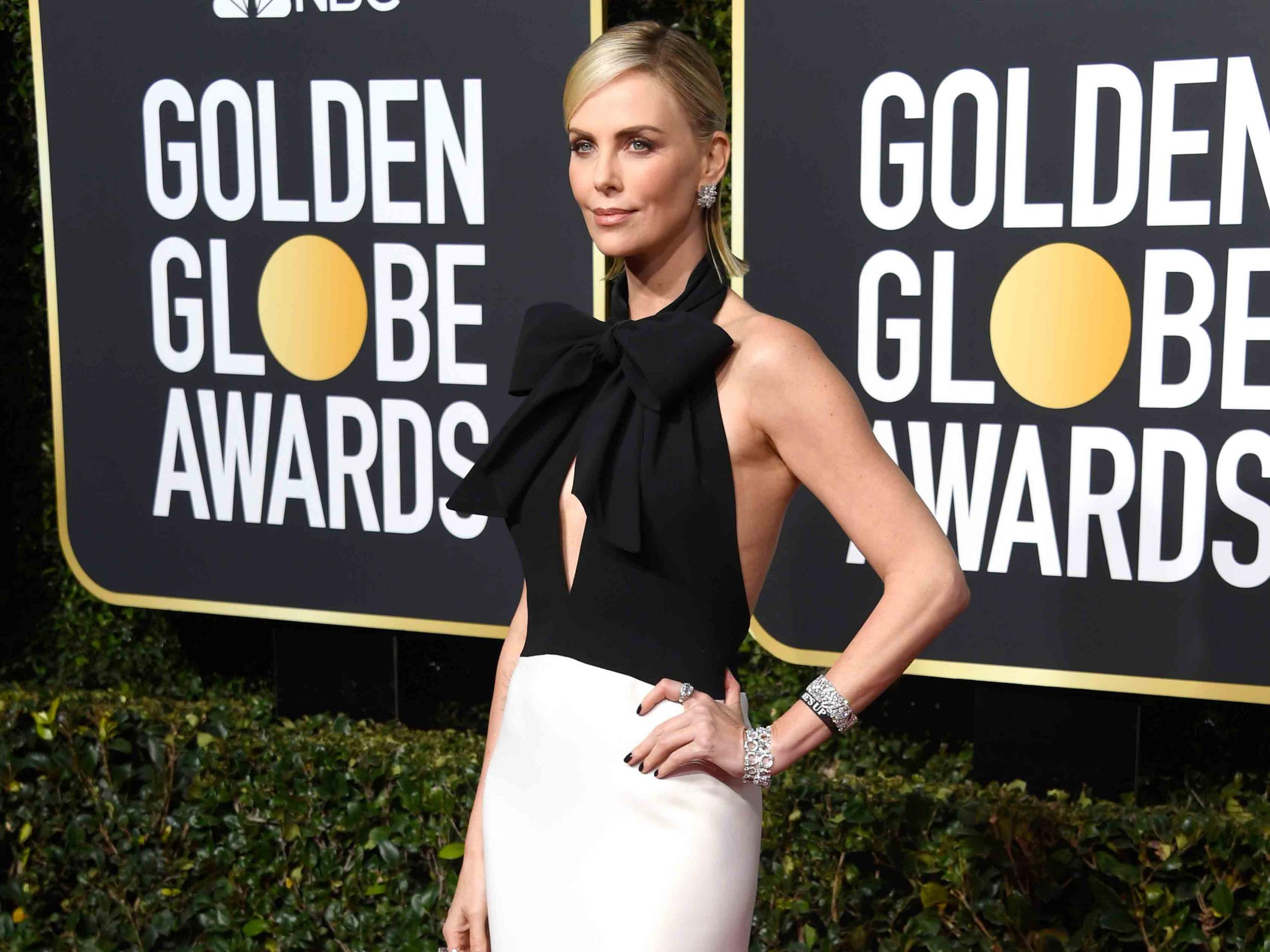 Golden Globes 2019: Stars wear Time's Up bracelets and pins in protest at sexual harassment
