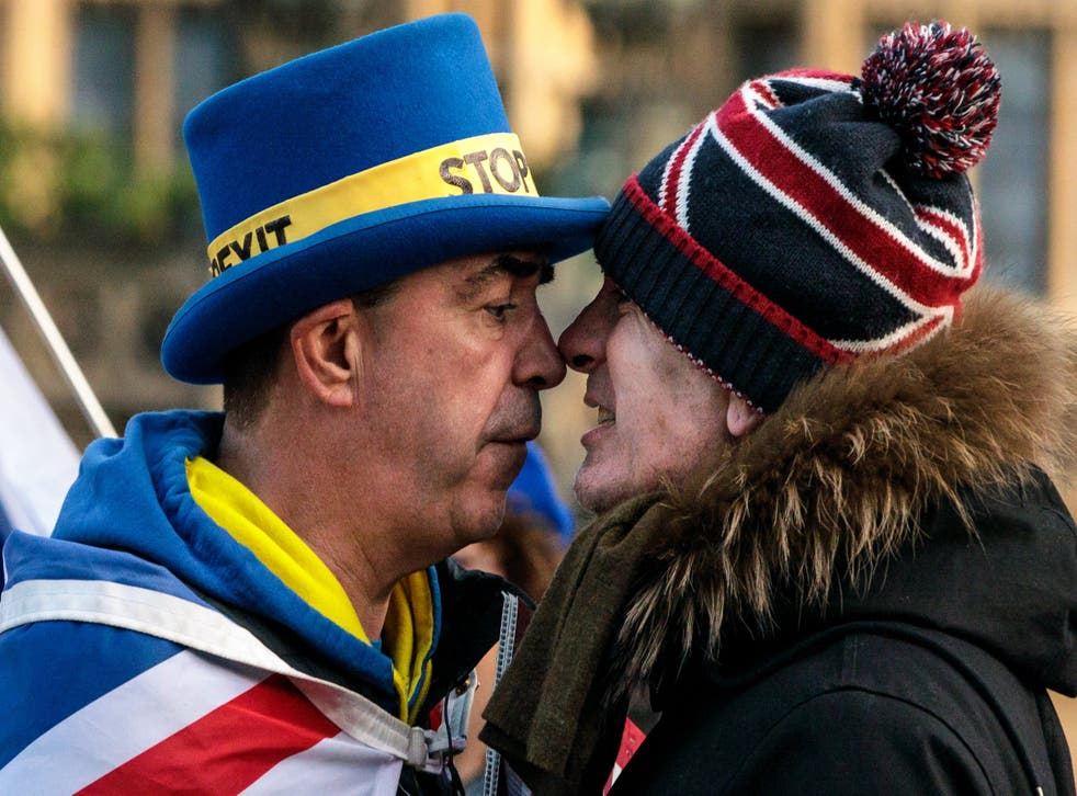 Anti-Brexit protester Steve Bray (left) and a pro-Brexit protester argue as they demonstrate outside the Houses of Parliament in Westminster on Tuesday