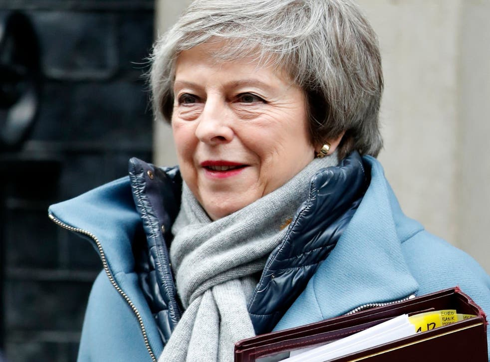 Theresa May leaves 10 Downing Street for the House of Commons for her weekly Prime Minister's question time