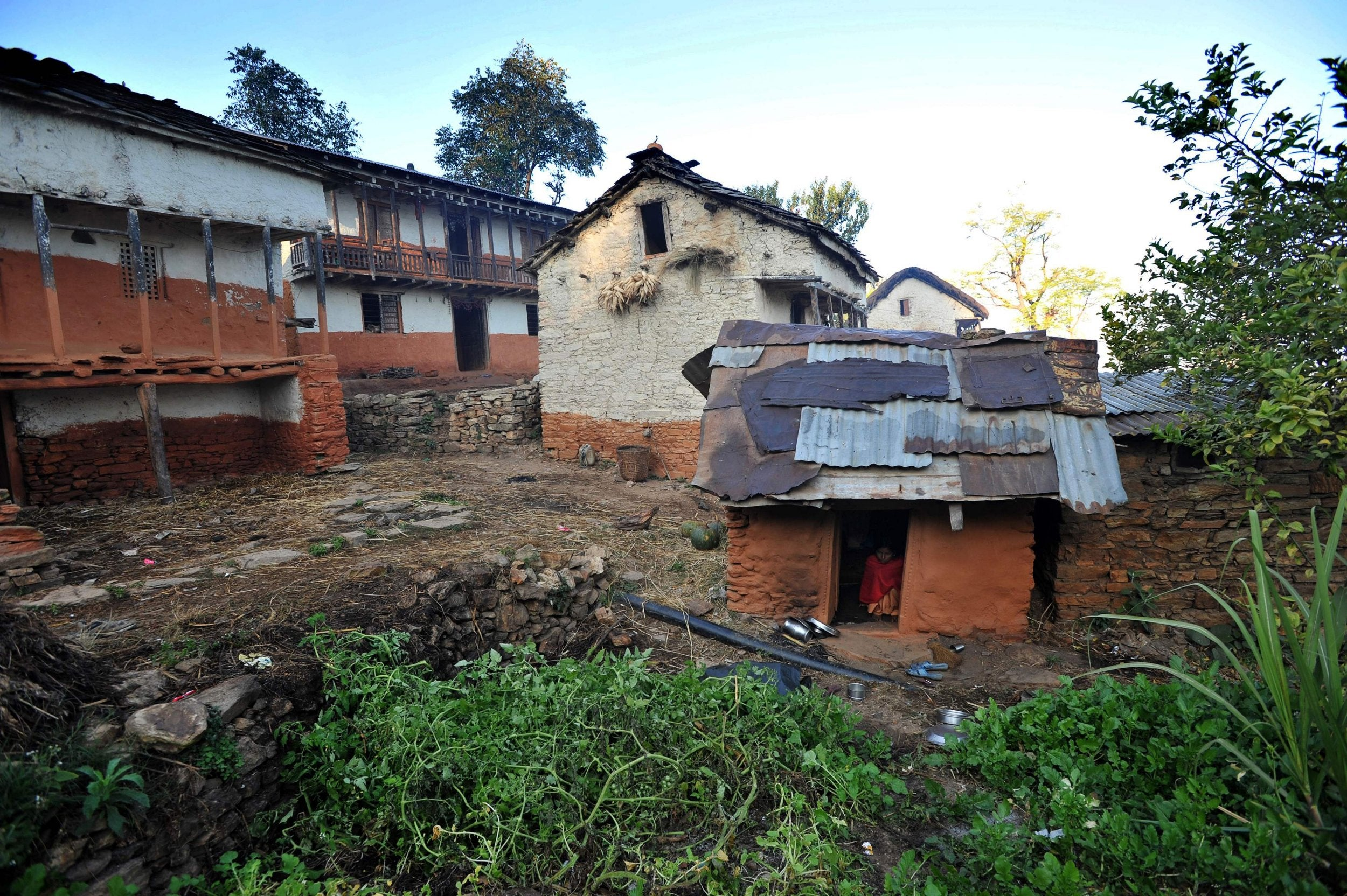 Nepalese woman and her children die in hut after being banished for menstruating