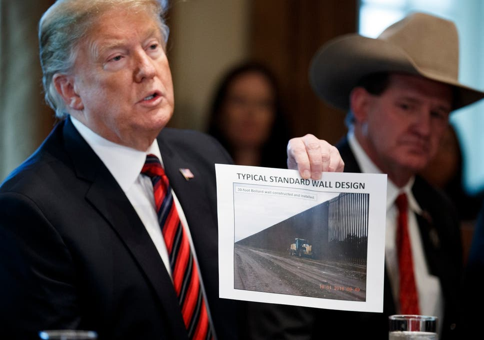 acd5f9c4e President Donald Trump presents a 'typical standard wall design' as he  participates in a