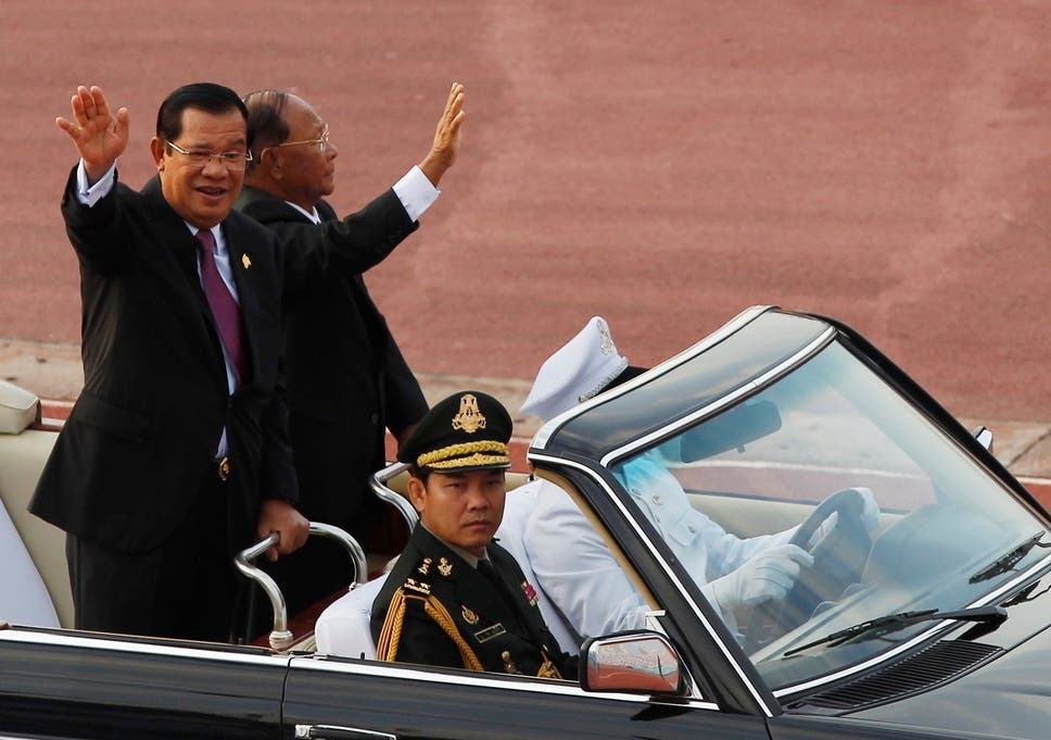 pm hun sen left waves to government civil servants with his national assembly president heng