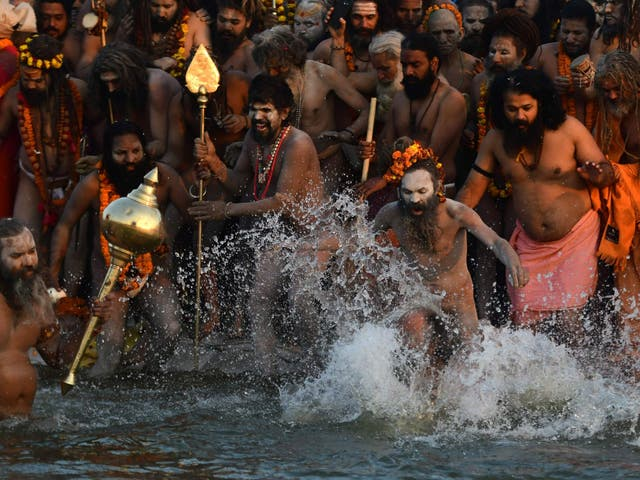 Indian sadhus take a dip at the holy Sangam – the confluence of the Ganges, Yamuna and mythical Saraswati rivers