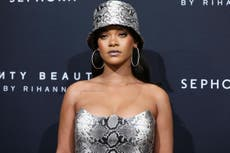 ff17d984c2 Rihanna  sues her father for allegedly exploiting their last name