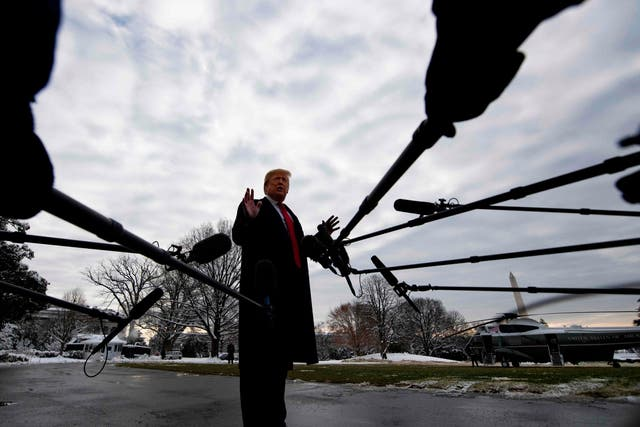 """US President Donald Trump speaks to the media as he departs the White House in Washington, DC, 14 January 2019 en route to New Orleans, Louisiana to address the annual American Farm Bureau Federation convention. Mr Trump said Monday he has """"never worked for Russia."""""""