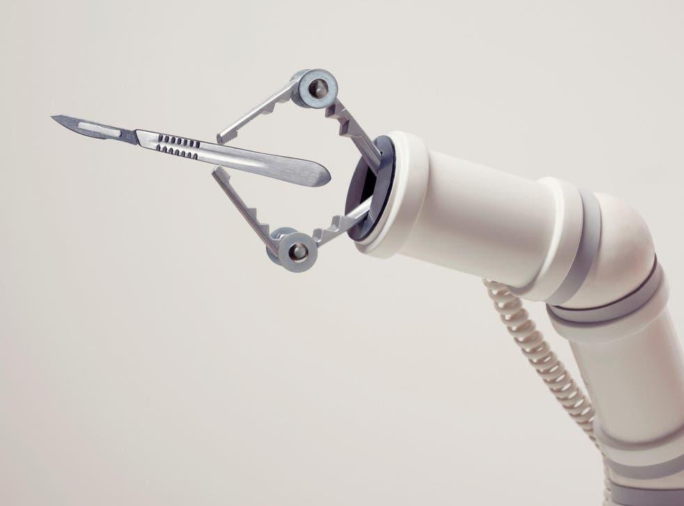 A robotic arm with a scalpel
