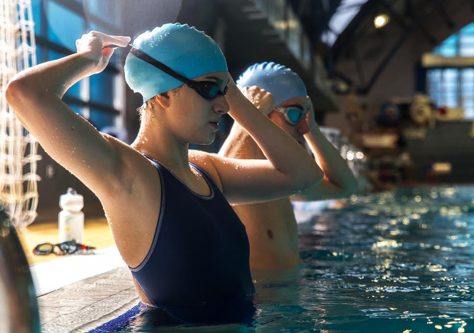 a59a730ac90 Most performance swim hats are made with silicone, making them stretchy  enough to work for