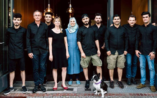 Andreas Tölke, second from left, with asylum seekers that have worked at Kreuzberger Himmel
