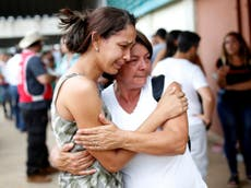 Hopes fade for hundreds missing as search suspended at Brazilian dam