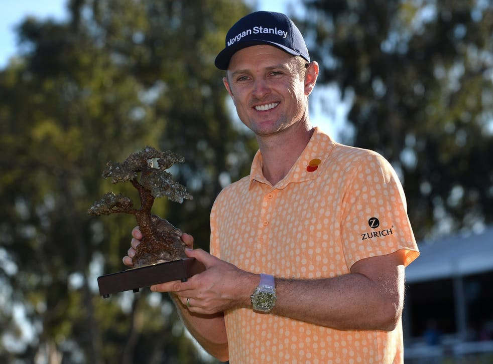 Justin Rose lifts the Farmers Insurance Open title