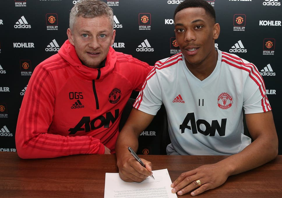 Anthony Martial signs on the dotted line to extend his stay