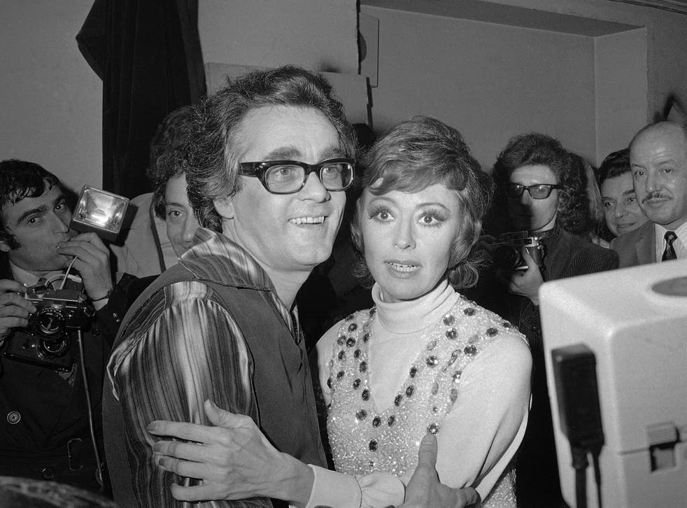 Michel Legrand and Italian singer Caterina Valente embrace after their show a the Olympia concert hall, Paris, in 1972