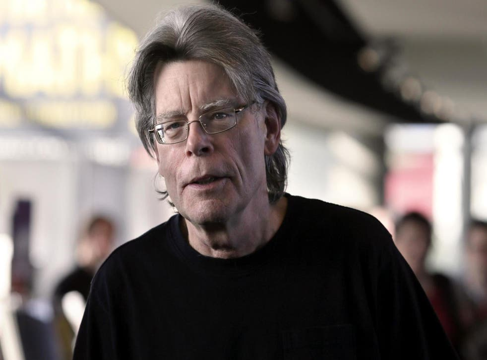 Stephen King poses for photographers on 13 November, 2013 in Paris, before a book signing event dedicated to the release of his new book Doctor Sleep, the sequel to his 1977 novel The Shining.