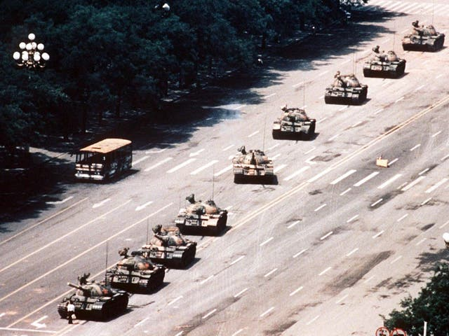 Wang Weilin defies the tanks as they roll into Tianamen square in June 1989. Thousands of students in Beijing took to the streets in a pro-democracy demonstration