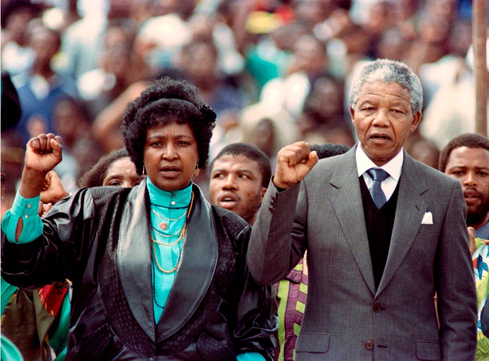 Nelson Mandela and his then-wife Winnie at a rally on 13 February 1990, just two days after the anti-apartheid leader was released from prison