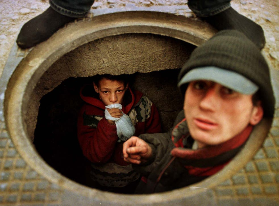 Going underground: 13-year-old Bogdan prefers to live in a Bucharest sewer than go back to the orphanage where he was beaten
