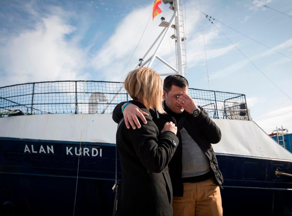 Abdullah Kurdi and his sister Tima in front of the Sea-Eye rescue ship in Mallorca