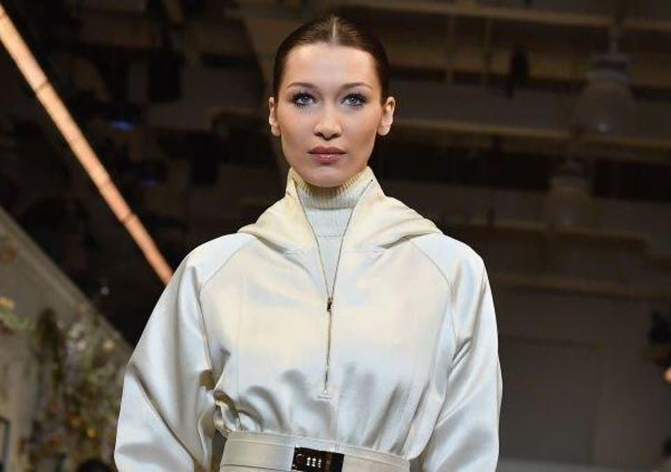 20de92f75a07 Bella Hadid ditches catwalk to become a hairstylist backstage at New York  Fashion Week