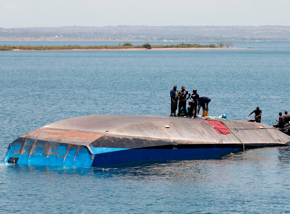 Tanzanian rescue workers search for victims a day after the ferry MV Nyerere capsized in Lake Victoria