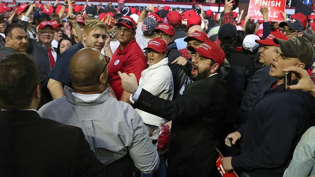 Supporters yell as protesters are removed at Trump rally in Texas on February 11