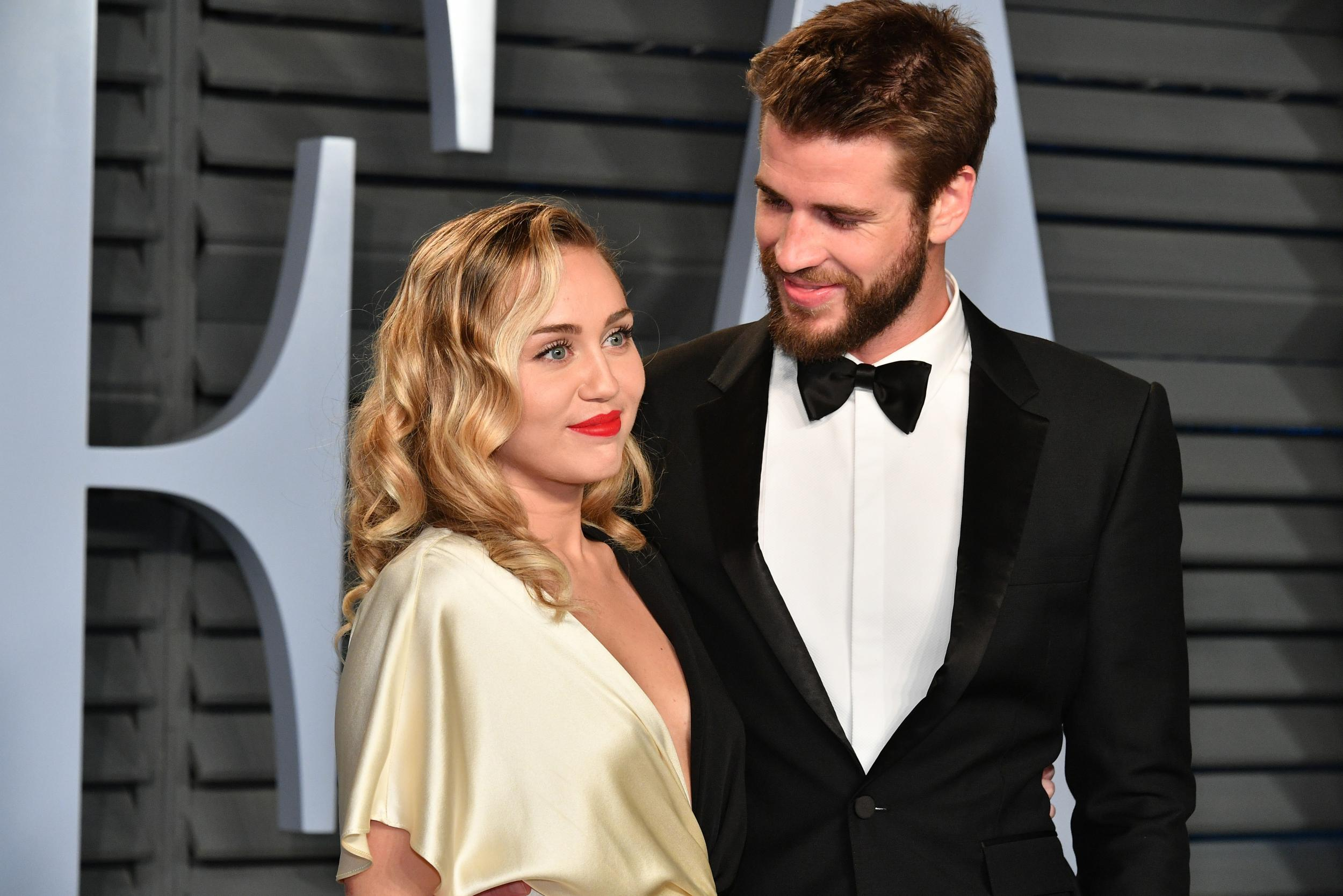 Miley Cyrus shares photos of vegan wedding to Liam Hemsworth