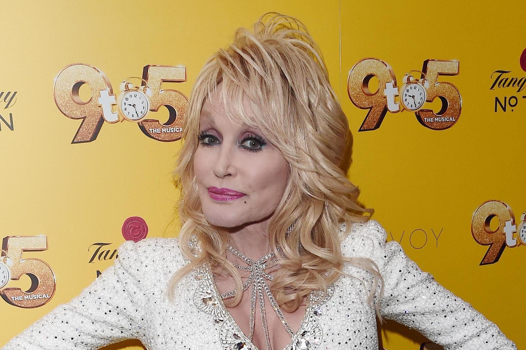 Dolly Parton doesn't label herself a 'feminist': 'I think I just live my femininity'
