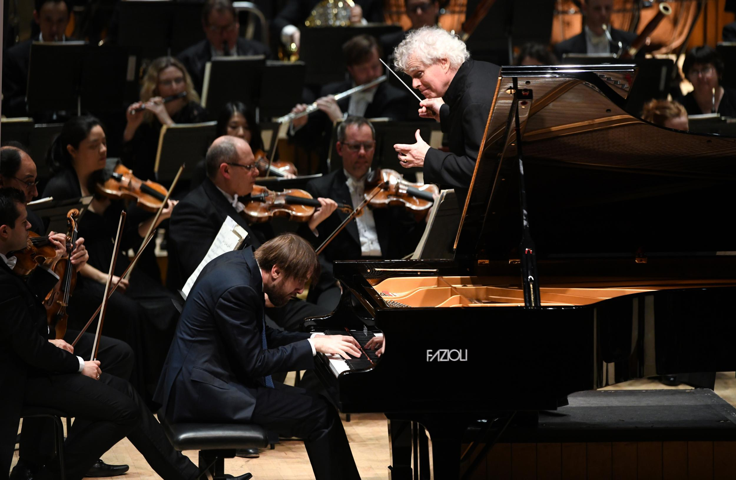 Daniil Trifonov at the Barbican, London, review: Pianist carries Simon Rattle and LSO into exuberant overdrive