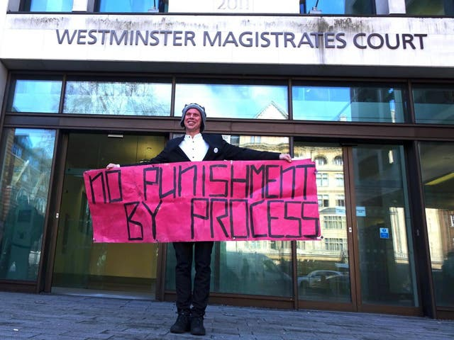 Lauri Love poses outside Westminster Magistrates Court on 19 February 2019 after a judge rules he will not get his computer equipment back