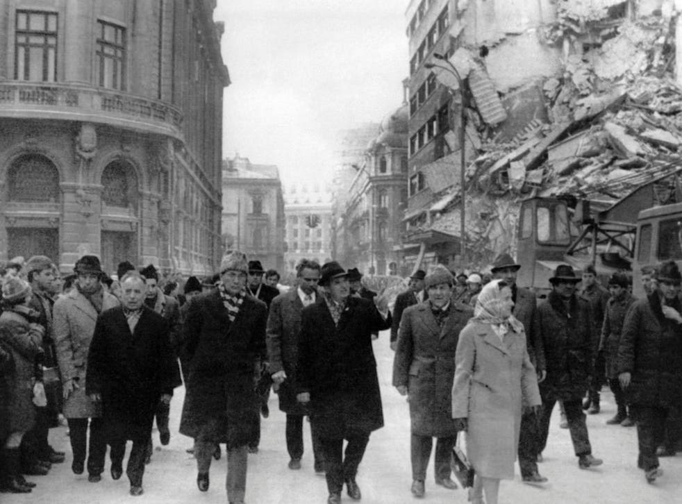 Romanian president Nicolae Ceausescu (centre) observes the damage in Bucharest after the Vrancea earthquake in 1977
