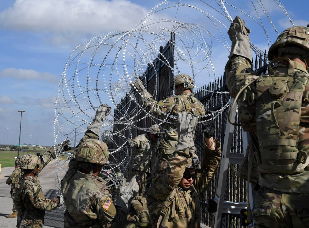 Troops currently stationed at the US-Mexico border have been ordered to string more concertina wire and install detection systems in remote areas, US defence official says