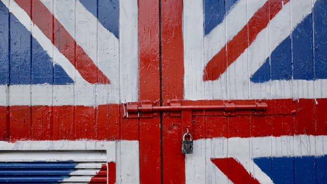 A garage door displaying unionism, bolted shut, like a visual representation of Brexit Britain, locked to outsiders, safeguarding what's inside