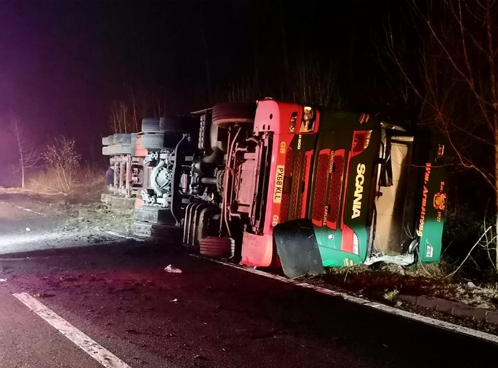 The lorry overturned on the A76 near Enterkinfoot, south of Sanquhar, Dumfries and Galloway