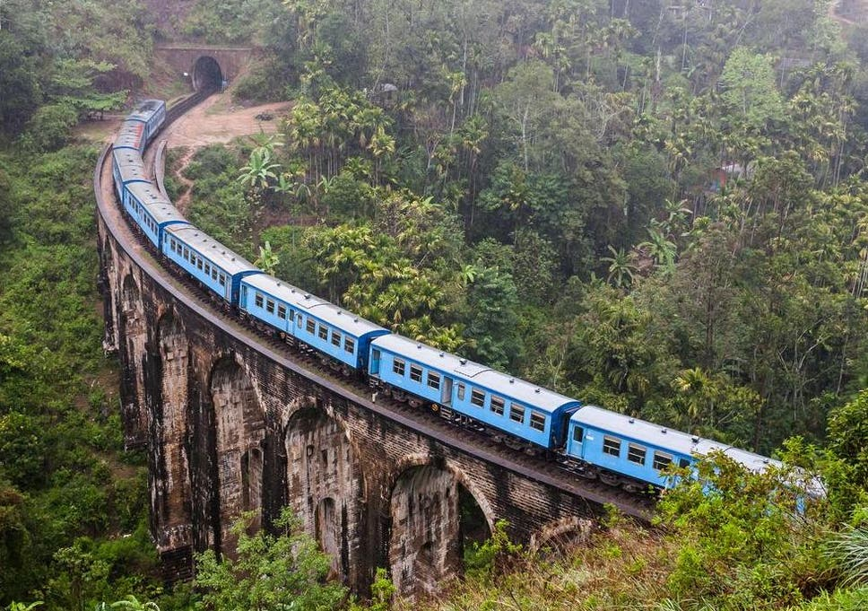 Travel bloggers criticised for hanging out of moving train