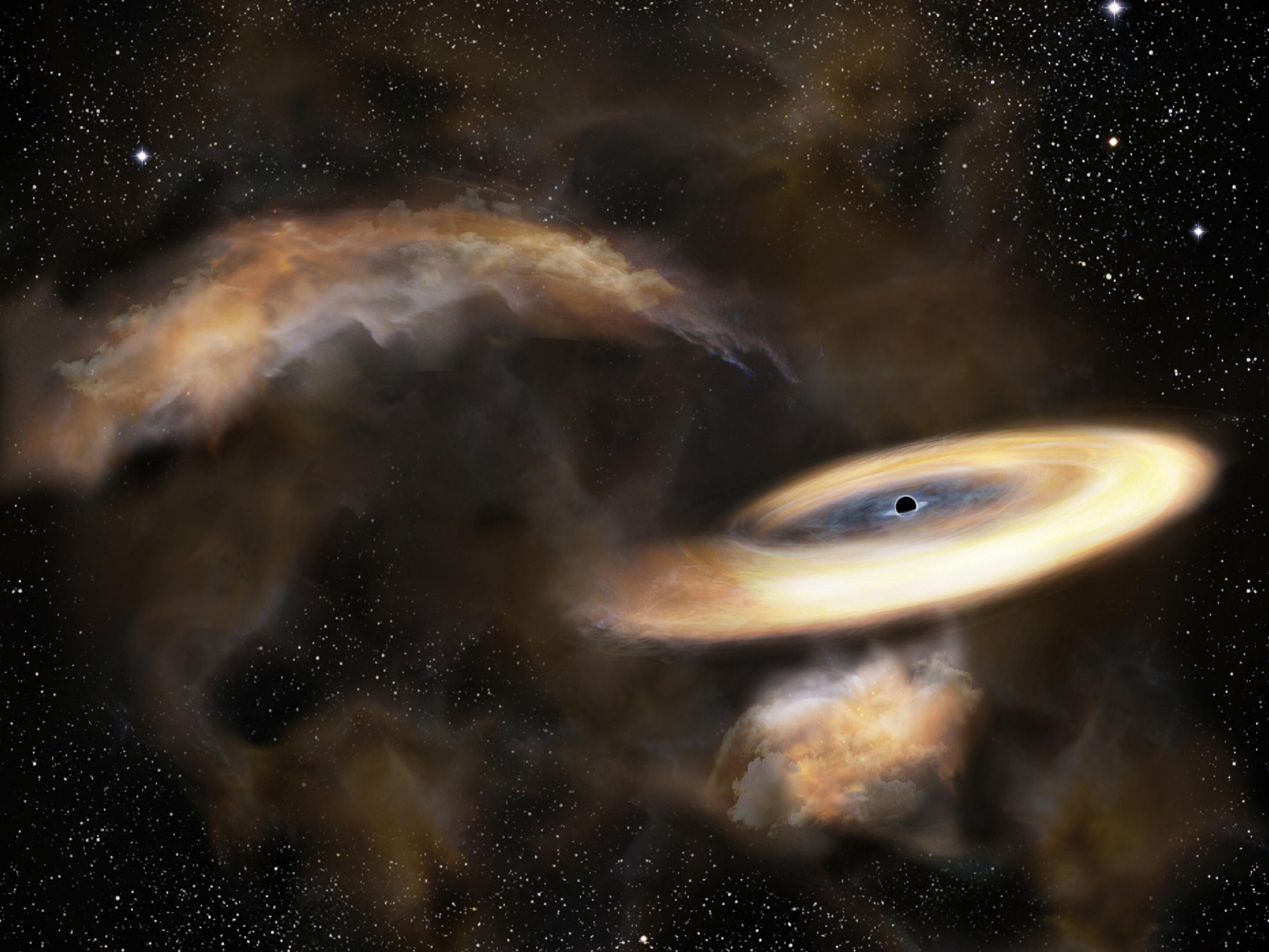 Black hole discovered hiding behind gas cloud in the depths
