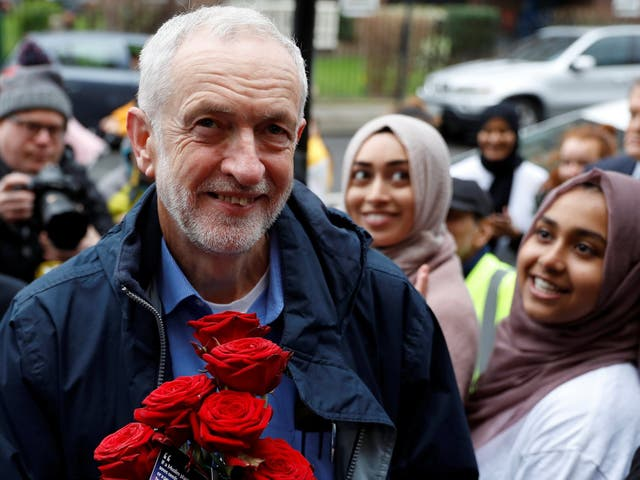 Jeremy Corbyn is greeted with red roses during a visit to Finsbury Park Mosque