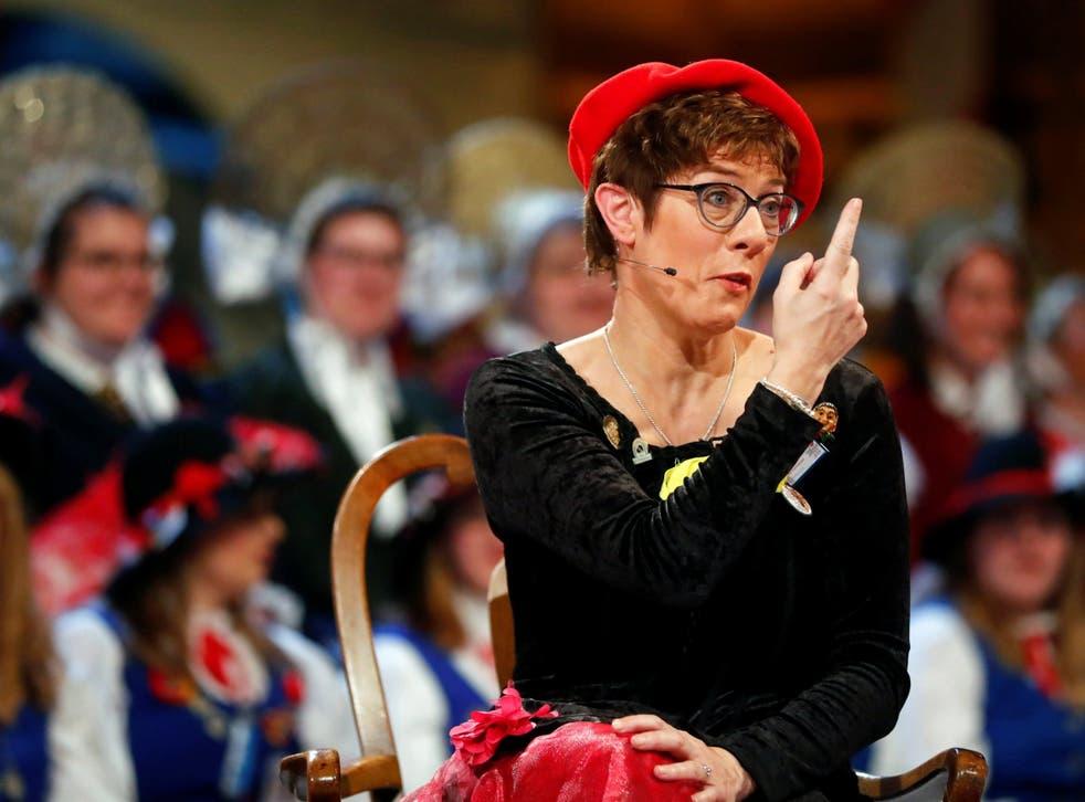 Annegret Kramp-Karrenbauer delivering her satirical speech in fancy dress during carnival festivities last week