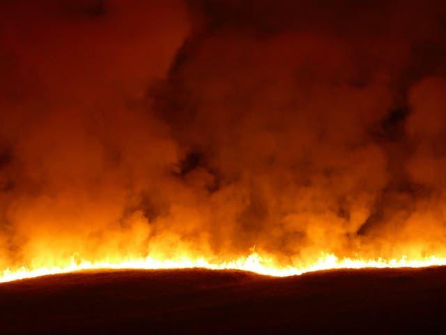 A large blaze engulfs Saddleworth Moor in West Yorkshire
