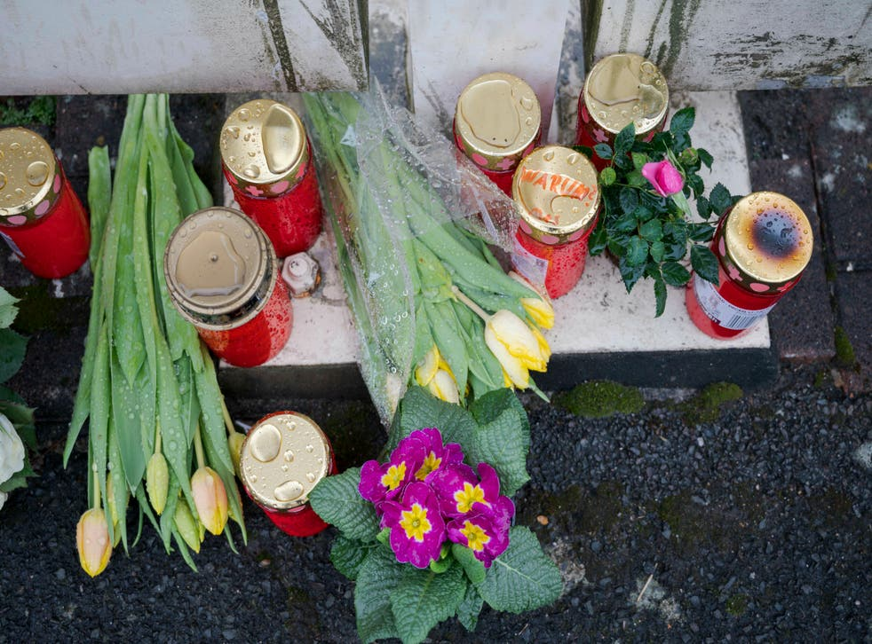 Flowers at the home of a doctor, who died in an explosion in Enkenbach-Alsenborn in Germany