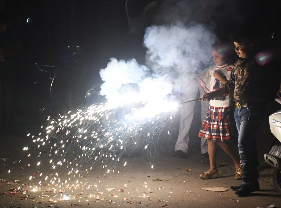 Indian children light firecrackers during Diwali festival