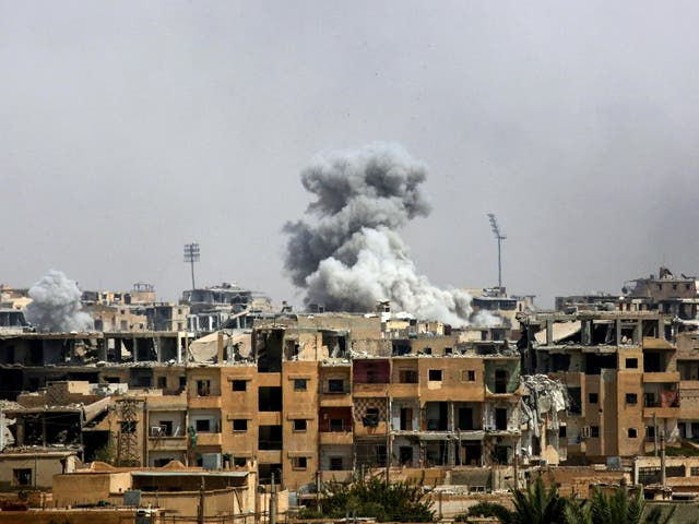 Smoke billows following a coalition airstrike in Raqqa in September 2017