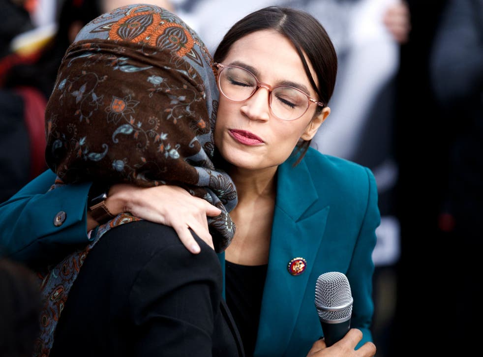 Ms Ocasio-Cortez embraces Ms Omar during a press conference in February