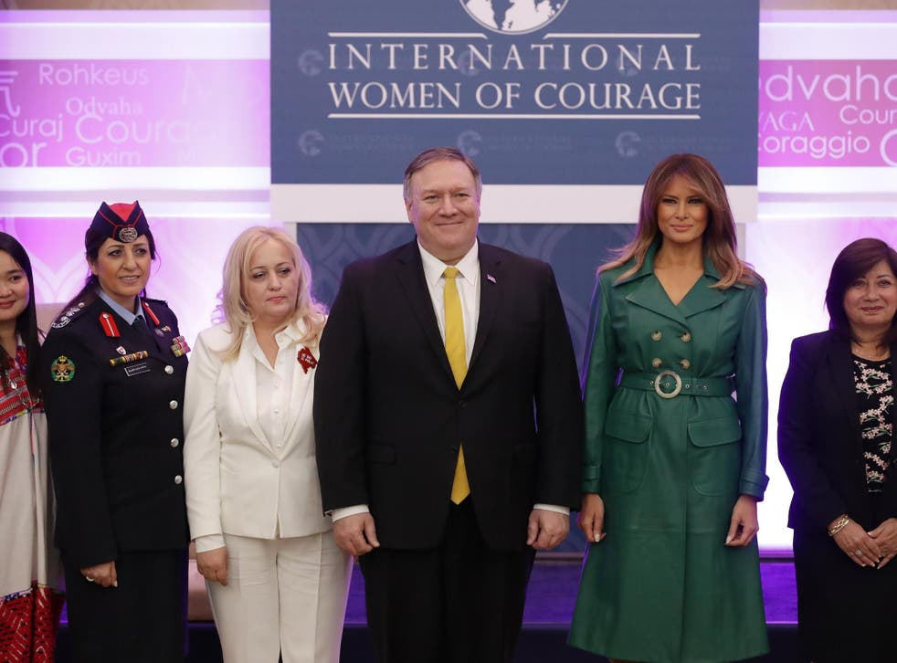 First lady Melania Trump and State Secretary Mike Pompeo pose alongside International Women of Courage awardees at the Department of State's Harry S. Truman building March 07, 2019.