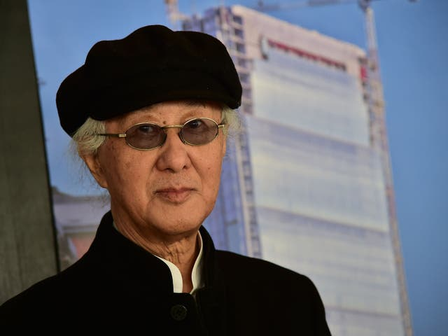 "Japanese architect Arata Isozaki poses before a press conference at the ""City Life office Tower"", a skyscraper under construction in Milan on 29 October, 2014. Isozaki won the Pritzker Prize for his contribution to architecture"