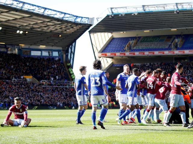 Grealish sits on the turf after being attacked