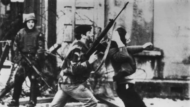 A British soldier attacks a protester in Derry on Bloody Sunday