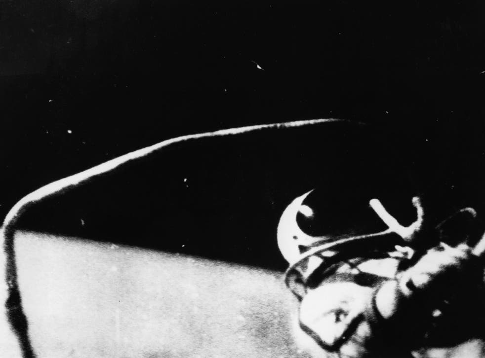 Russian astronaut Alexei Arkhipovich Leonov steps from the spaceship Voskhod 2 to become the first man to walk in outer space